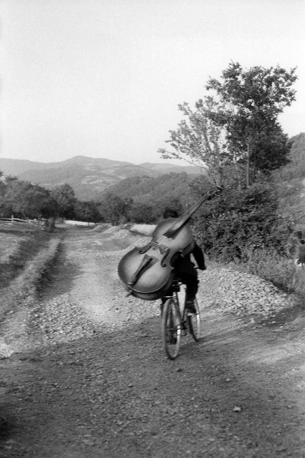 Bass player on the way to play at a village festival Serbia. Henri Cartier-Bresson, 1965